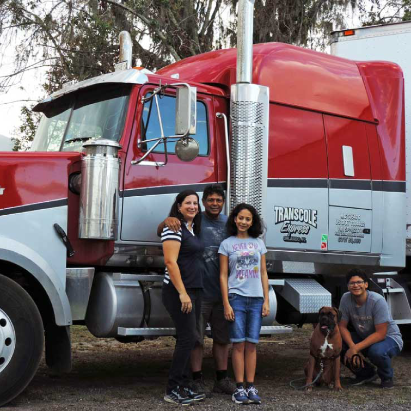 Transcole Express Family standing by their truck