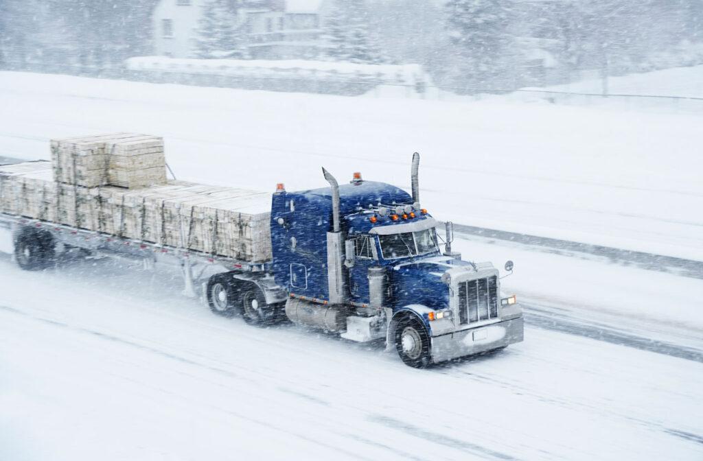 Semi Driving in Snow
